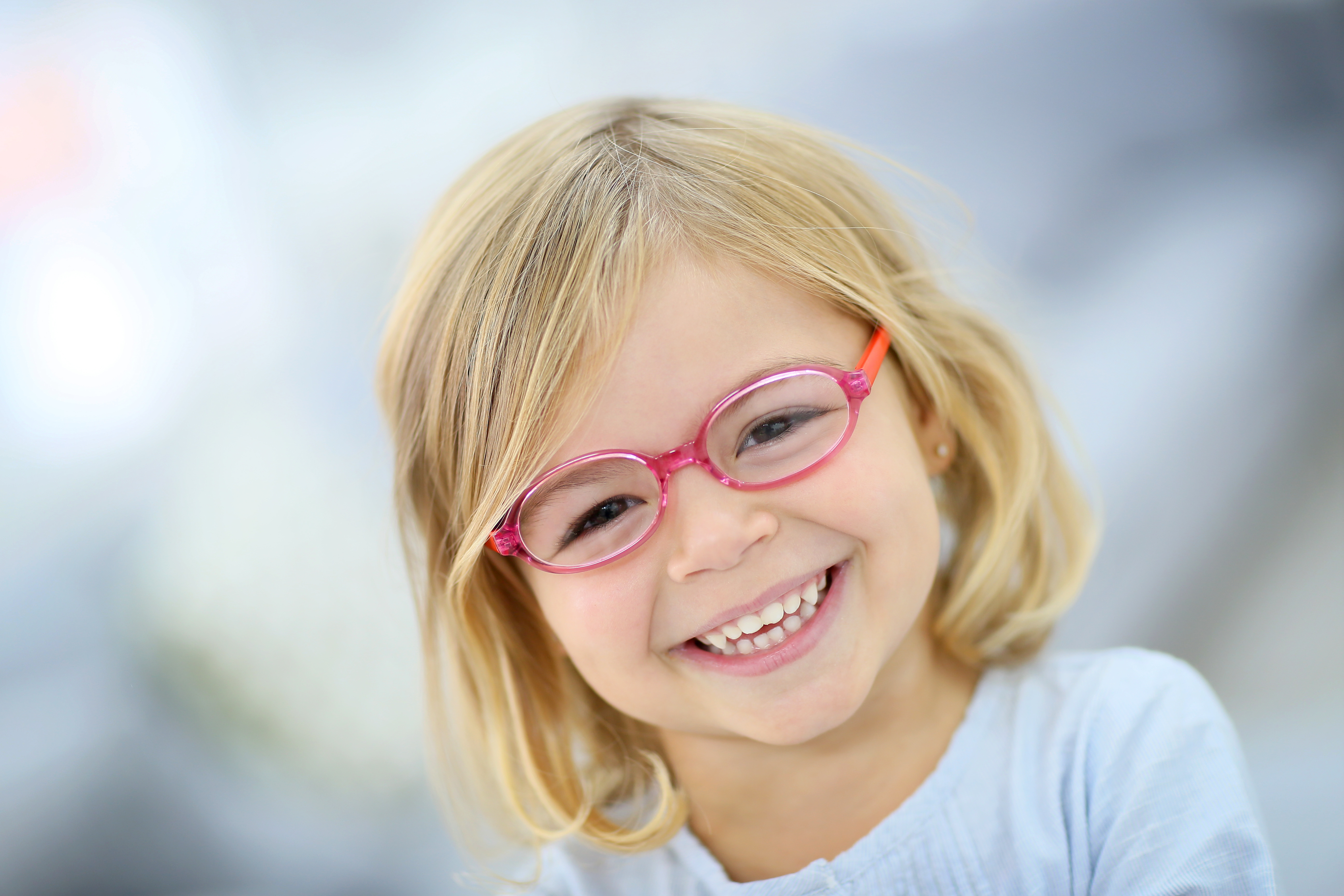 kid smile with spect